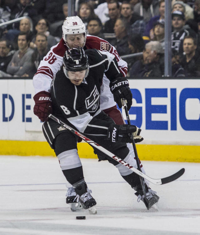 Los Angeles Kings defenseman Drew Doughty (8) and Phoenix Coyotes forward Brandon Mcmillan (38) tangle during the first period of an NHL hockey game, Wednesday, April 2, 2014, in Los Angeles. (AP Photo/Ringo H.W. Chiu)