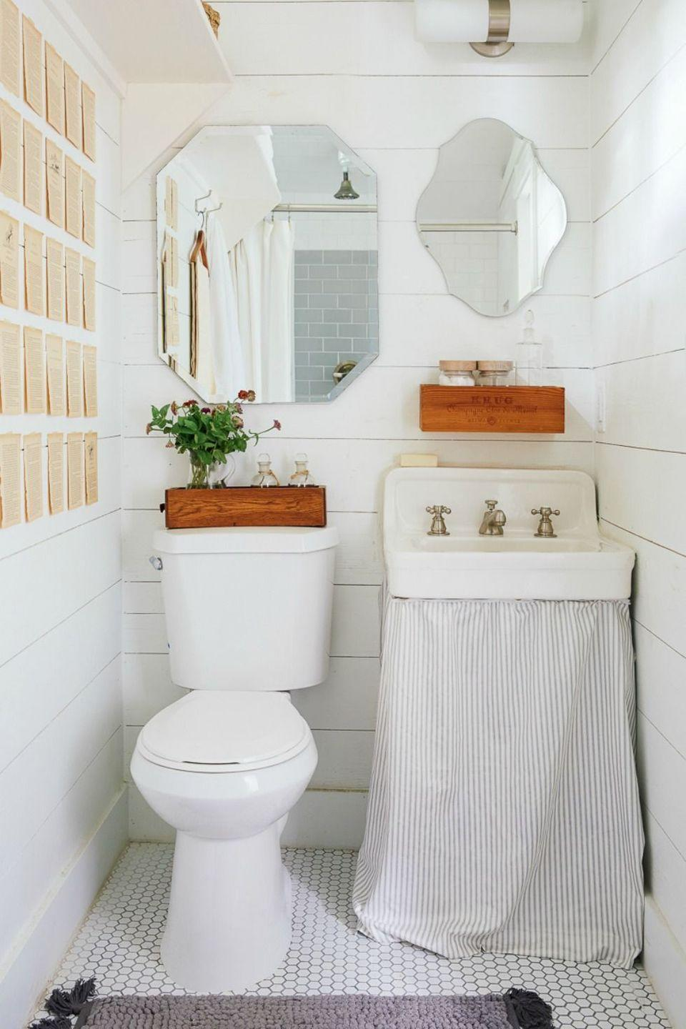 <p>White penny tiles and white-washed siding prevent this small bathroom from feeling cramped. </p>