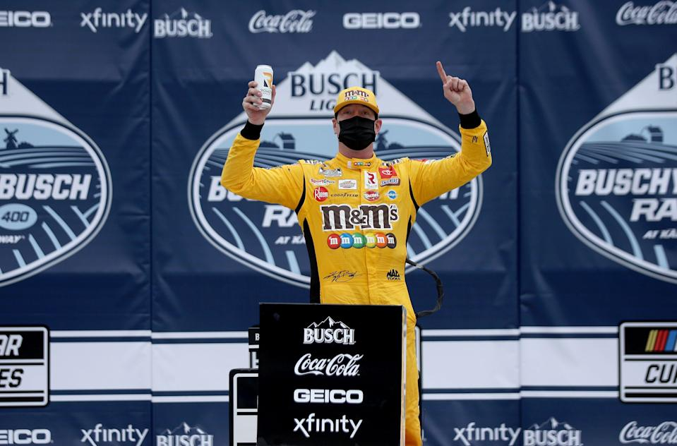 Kyle Busch celebrates in victory lane after winning the Buschy McBusch Race 400 at Kansas Speedway.