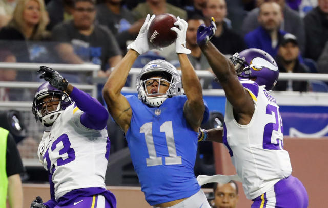 <p>Detroit Lions wide receiver Marvin Jones (11), guarded by Minnesota Vikings cornerbacks Terence Newman (23) and Xavier Rhodes (29), catches a 43-yard pass for a touchdown during the second half of an NFL football game, Thursday, Nov. 23, 2017, in Detroit. (AP Photo/Rick Osentoski) </p>