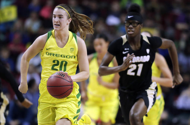 FILE - In this Friday, March 2, 2018 file photo, Oregon's Sabrina Ionescu (20) drives down the court ahead of Colorado's Mya Hollingshed, right, during the first half of an NCAA college basketball game in the quarterfinals of the Pac-12 Conference women's tournament in Seattle. (AP Photo/Ted S. Warren, File)