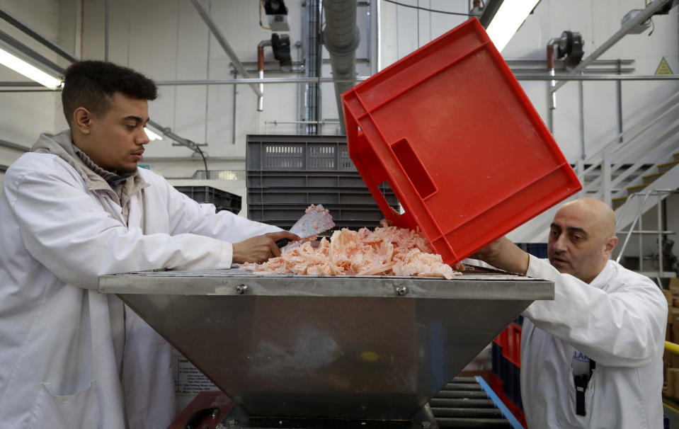 """FILE - In this Thursday, Jan. 17, 2019 file photo, Shane Bedasee, left, and Ozzie Ibrahim, right, work preparing soap at the Clarity-The Soap Co. premises in London. The U.K. election result means Britain's departure from the European Union will almost certainly happen - after multiple delays - on Jan. 31, as scheduled. But for companies that have had to plan for all sorts of potentially chaotic outcomes to Brexit, even just a little clarity is a breath of fresh air. """"The idea that the situation with Brexit is going to be resolved is good for business,"""" said Andy Zneimer, who handles communications for a small soap business in east London called Clarity-The Soap Co. (AP Photo/Kirsty Wigglesworth, file)"""