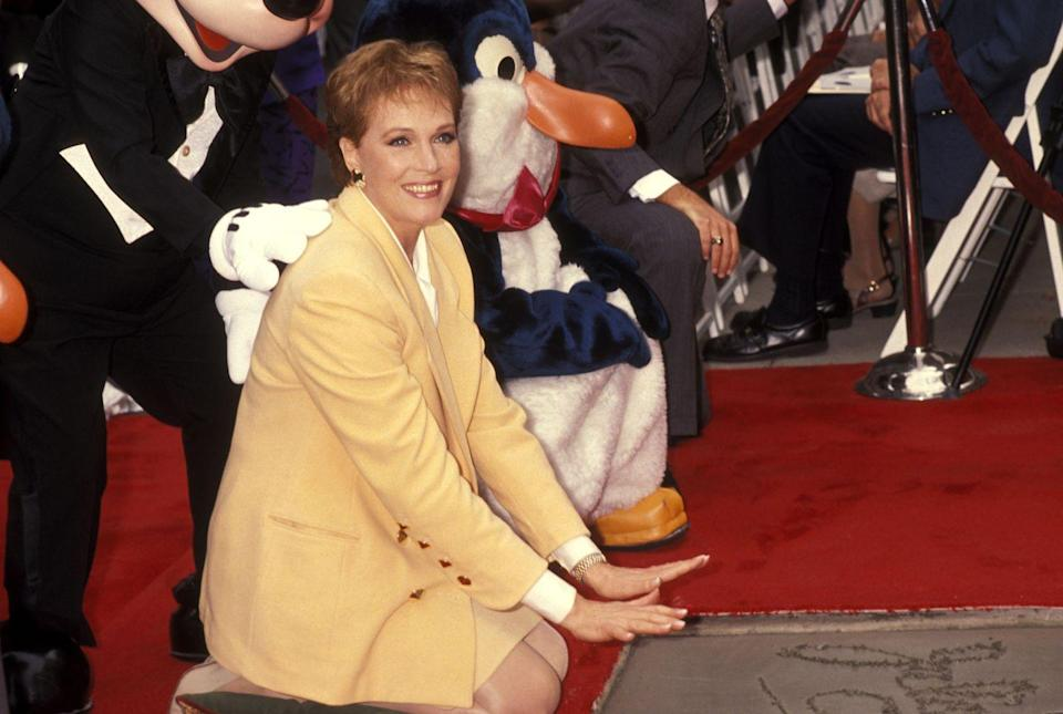<p>Andrews puts her handprints in cement after the Fourth Annual Disney Legends Awards at Walt Disney Studios in Burbank, California.</p>