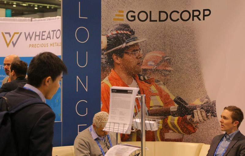 FILE PHOTO: A visitor reads a pamphlet at the Goldcorp gold mining company booth during the PDAC convention in Toronto
