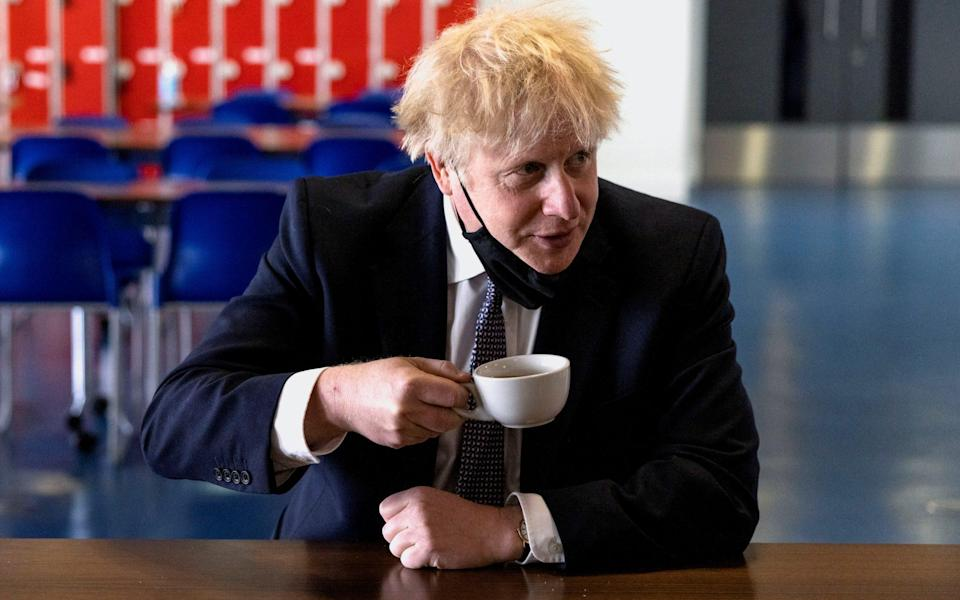 Boris Johnson, pictured during a visit to an academy in London last month, is '99 per cent' certain to announce the change on Monday, according to a source - Dan Kitwood/Pool via Reuters
