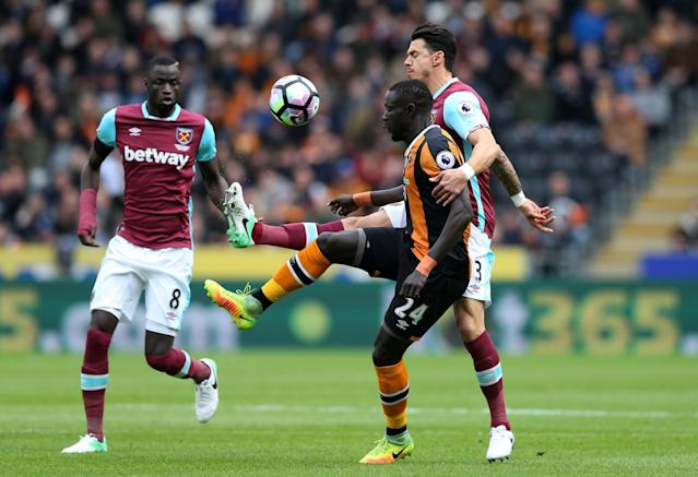 <p>Hull City's Oumar Niasse in action with West Ham United's Jose Fonte </p>