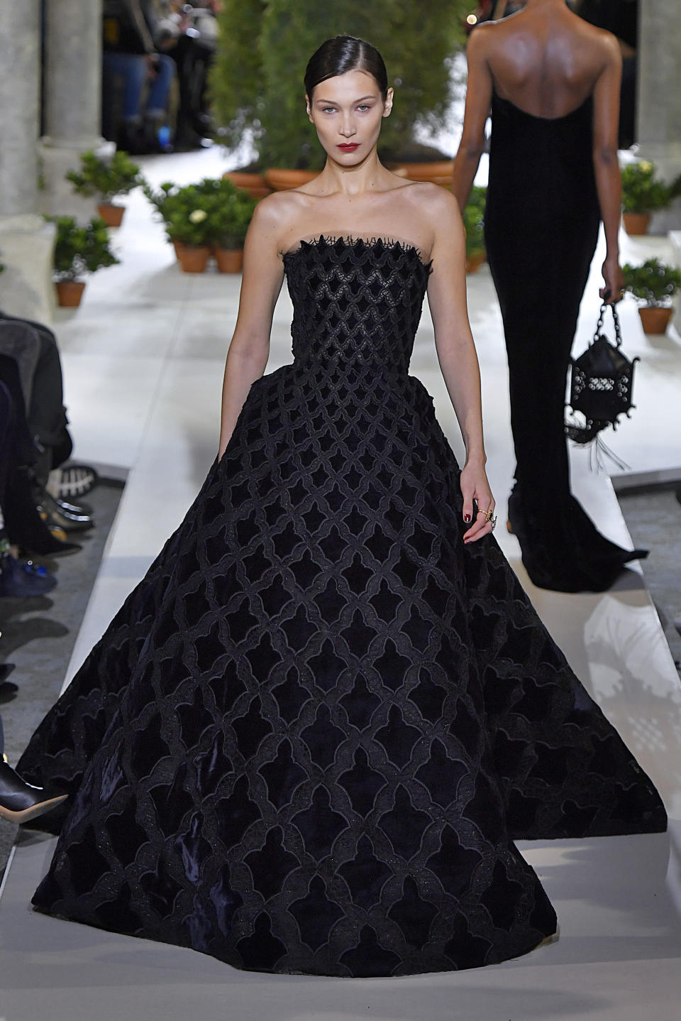 <p>Gigi's younger sister Bella Hadid also proved a talking point at the Oscar de la Renta show courtesy of a showstopping cold-shoulder gown.<em> [Photo: Getty]</em> </p>