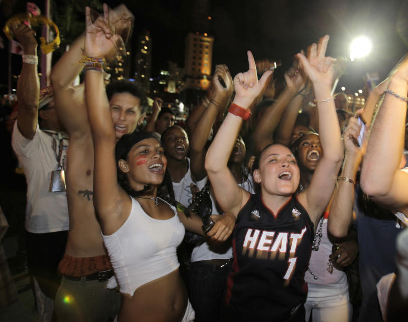 Miami Heat fans celebrate outside American Airlines Arena in Miami, Thursday, May 26, 2011, after the Heat defeated the Chicago Bulls 83-80 in Game 5 of the NBA Eastern Conference basketball finals in Chicago to advance to the NBA Finals. (AP Photo/Lynne Sladky)