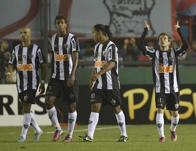 Brazil's Atletico Mineiro forward Bernard (R) celebrates after scoring his second team's third goal against Argentina's Arsenal FC during their Copa Libertadores 2013 group 3 football match at Arsenal stadium in Sarandi, Buenos Aires, Argentina, on February 26, 2013. AFP PHOTO / Juan MabromataJUAN MABROMATA/AFP/Getty Images