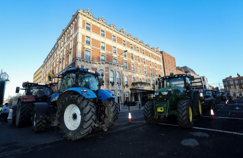 Farmers protest on St. Stephens Green, near Government Buildings in Dublin