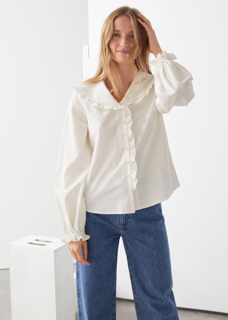 "<br><br><strong>& Other Stories</strong> Boxy Button Up Ruffle Blouse, $, available at <a href=""https://go.skimresources.com/?id=30283X879131&url=https%3A%2F%2Fwww.stories.com%2Fen_usd%2Fclothing%2Fblouses-shirts%2Fblouses%2Fproduct.boxy-button-up-ruffle-blouse-white.0910417001.html"" rel=""nofollow noopener"" target=""_blank"" data-ylk=""slk:& Other Stories"" class=""link rapid-noclick-resp"">& Other Stories</a>"