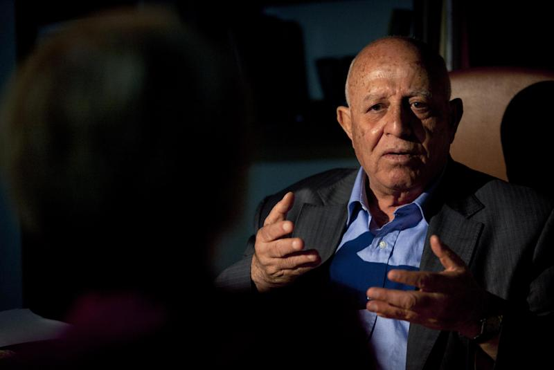 In this photo taken Monday, Sept. 9, 2013, former Palestinian Prime Minister and negotiator Ahmed Qureia talks during an interview with The Associated Press at his office in the West Bank town of Abu Dis, east of Jerusalem. Twenty years after the two sides signed the Declaration of Principles on the White House lawn, the words that launched Israeli-Palestinian talks on dividing the Holy Land into two states ring hollow to many on both sides. Negotiators said mistakes they made then cause damage to this day. (AP Photo/Nasser Nasser)