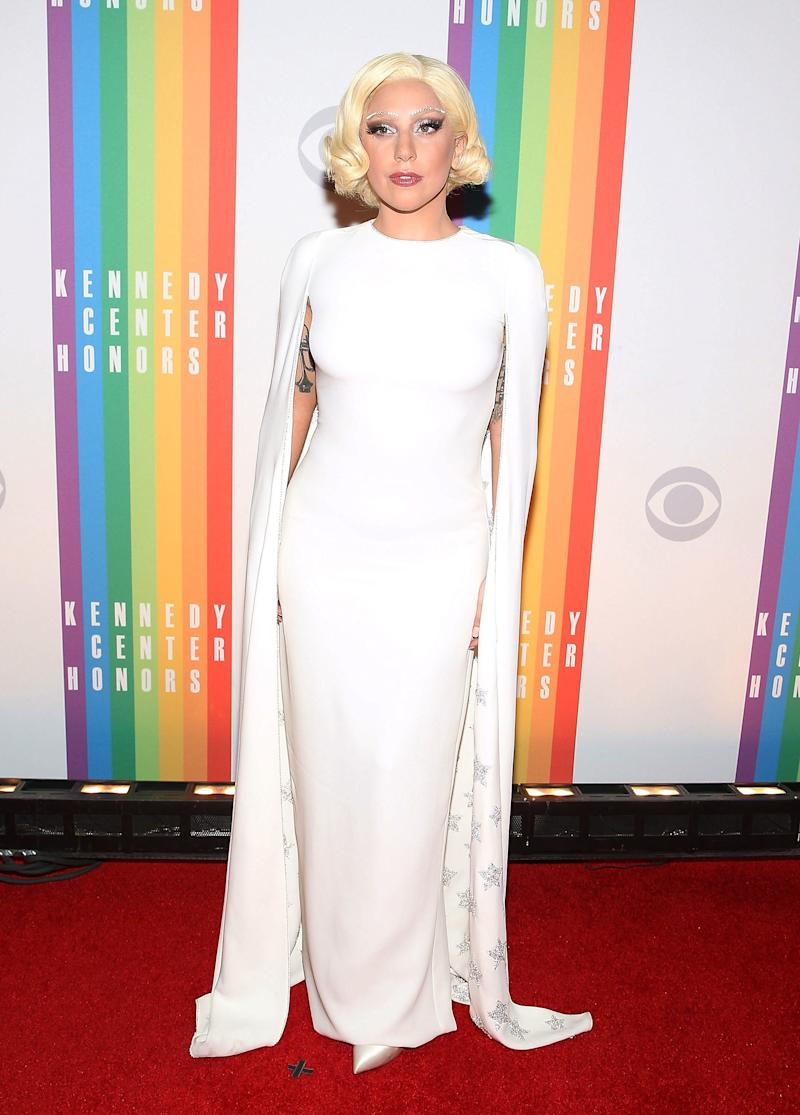 Wearing a star-spangled, custom white Valentino gown with diamante eyebrows to match at the Kennedy Center Honors.