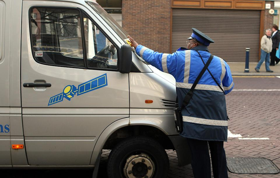 You can't park there! A warden issues a ticket in Solihull (PA)