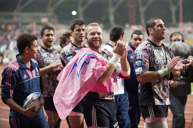 Stade Francais's winger Ollie Phillips (C) acknowledges the audience with team-mates after winning the European Challenge Cup semi final rugby union match Stade Francais vs. Clermont at the Charlety stadium in Paris on April 29, 2011. AFP PHOTO / BERTRAND LANGLOIS (Photo credit should read BERTRAND LANGLOIS/AFP/Getty Images)