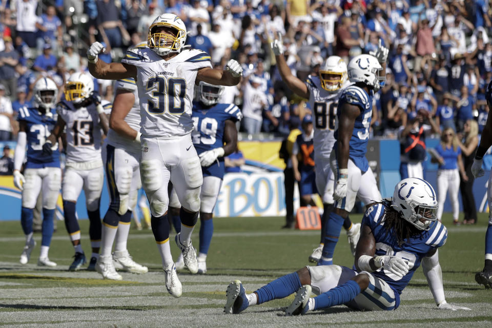 Los Angeles Chargers running back Austin Ekeler (30) celebrates after scoring the winning touchdown during overtime in an NFL football game against the Indianapolis Colts Sunday, Sept. 8, 2019, in Carson, Calif. (AP Photo/Marcio Jose Sanchez)