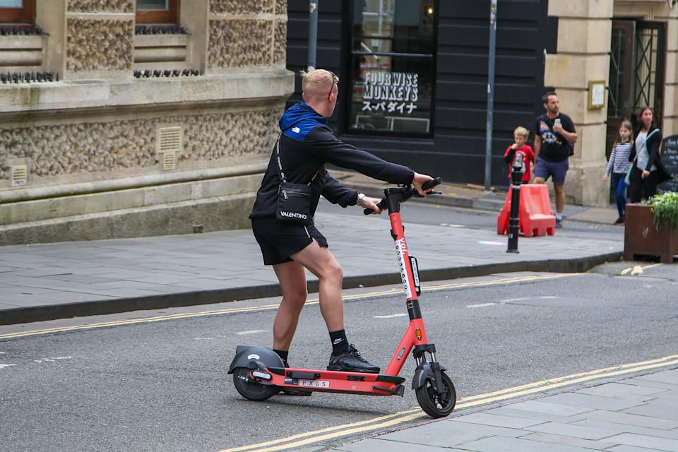 A man riding a VOI electric e scooter on a road in Bristol. Electric scooters cannot be ridden on the pavements and the user must hold a drivers license and comply by UK law. The e scooter must only be used by one person only and not multiple persons. (Photo by Dinendra Haria / SOPA Images/Sipa USA)