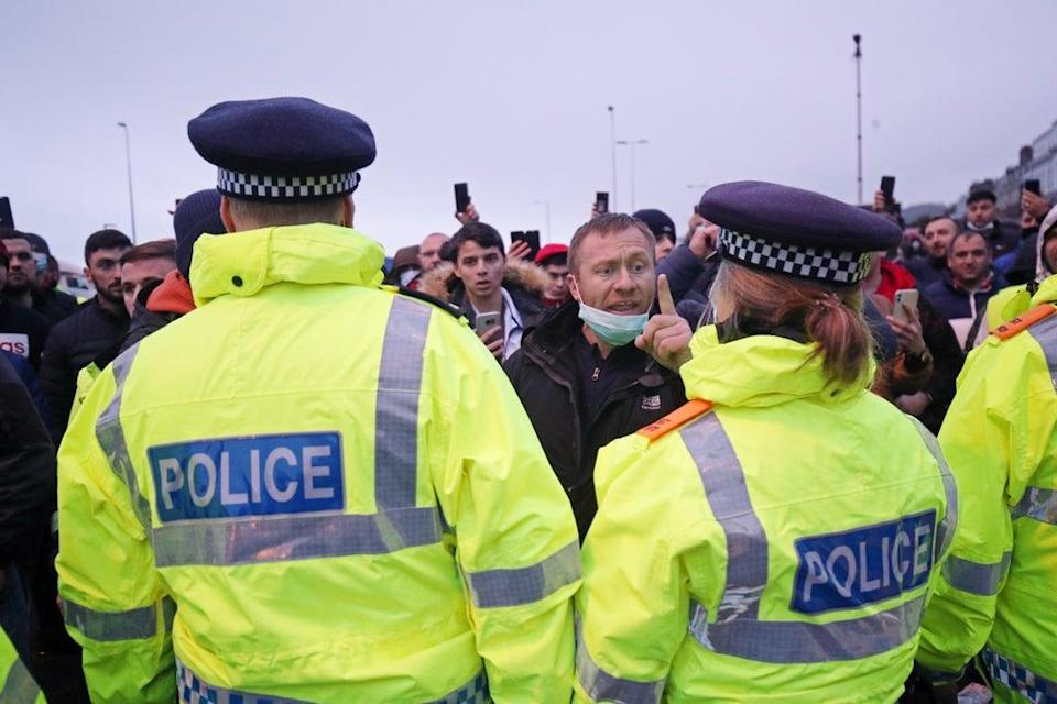 Police holding back drivers trying to enter the Port of Dover in Kent (Steve Parsons/PA) (PA Wire)