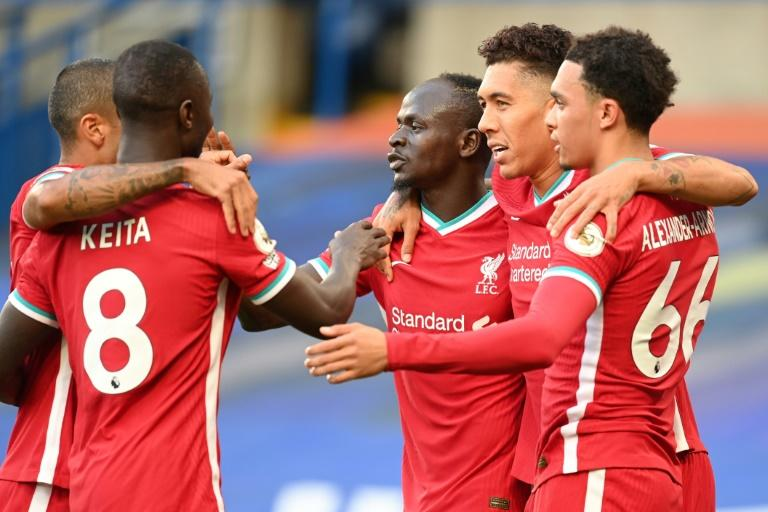 Relentless Liverpool raise bar for title rivals