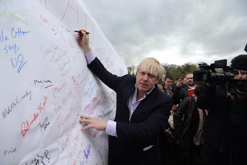 Then mayor of London Boris Johnson signs a giant petition at a rally in 2013 against the expansion of Heathrow Airport (Picture: PA)