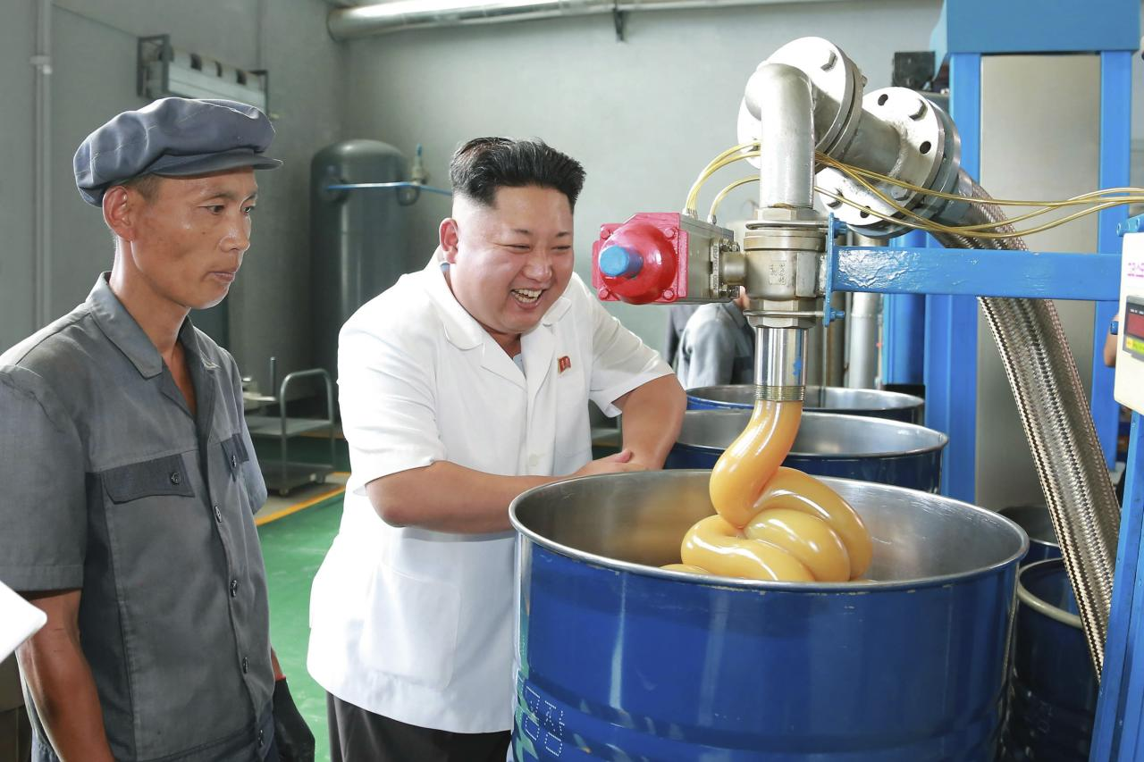 North Korean leader Kim Jong Un smiles during a visit to the Chonji Lubricant Factory, in this undated photo released by North Korea's Korean Central News Agency (KCNA) in Pyongyang August 6, 2014. REUTERS/KCNA (NORTH KOREA - Tags: POLITICS IMAGES OF THE DAY) ATTENTION EDITORS � THIS PICTURE WAS PROVIDED BY A THIRD PARTY. REUTERS IS UNABLE TO INDEPENDENTLY VERIFY THE AUTHENTICITY, CONTENT, LOCATION OR DATE OF THIS IMAGE. FOR EDITORIAL USE ONLY. NOT FOR SALE FOR MARKETING OR ADVERTISING CAMPAIGNS. NO THIRD PARTY SALES. NOT FOR USE BY REUTERS THIRD PARTY DISTRIBUTORS. SOUTH KOREA OUT. NO COMMERCIAL OR EDITORIAL SALES IN SOUTH KOREA. THIS PICTURE IS DISTRIBUTED EXACTLY AS RECEIVED BY REUTERS, AS A SERVICE TO CLIENTS