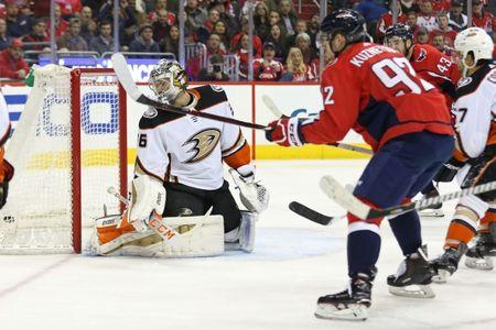 Dec 16, 2017; Washington, DC, USA; Washington Capitals center Evgeny Kuznetsov (92) scores a goal on Anaheim Ducks goalie John Gibson (36) in the third period at Capital One Arena. The Capitals won 3-2 in overtime. Mandatory Credit: Geoff Burke-USA TODAY Sports