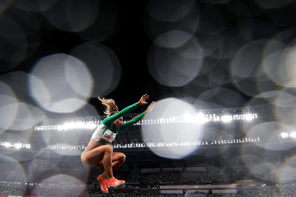 Portuguese athlete Claudia Santos competes in the Long Jump at the Tokyo Paralympics.