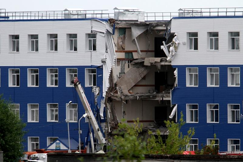 All four floors in one section of military barracks in the Siberian city of Omsk collapsed as 42 Russian paratroopers were resting on July 12, 2015 (AFP Photo/Dmitry Feoktistov)
