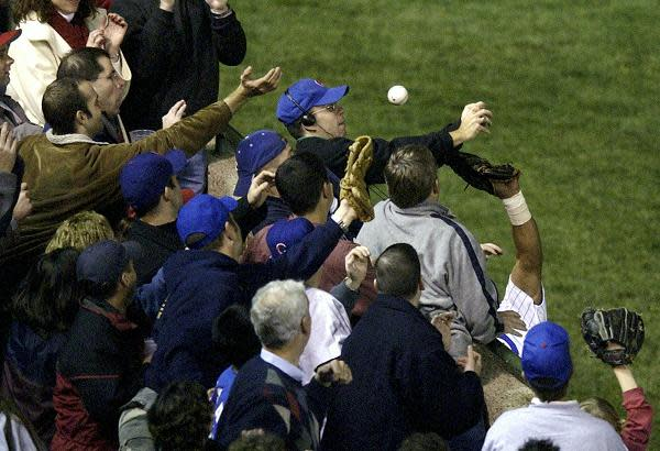 Chicago Cubs fan Steve Bartman interferes with left fielder Moises Alou's attempt to catch a foul ball during Game 6 of the National League Championship Series Chicago. (AP)