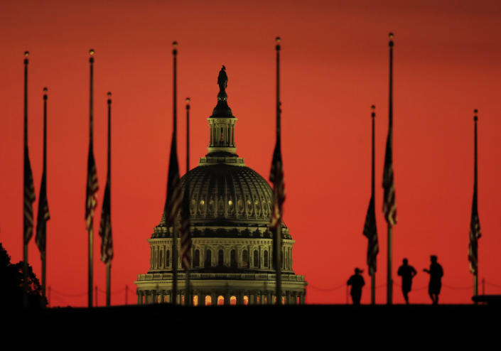 <p>The U.S. Capitol dome backdrops flags at half-staff in honor of the victims killed in the Las Vegas shooting as the sun rises on Tuesday, Oct. 3, 2017, at the foot of the Washington Monument on the National Mall in Washington. (Photo: Manuel Balce Ceneta/AP) </p>