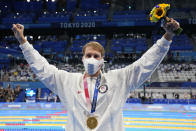 Gold medalist Chase Kalisz, of the United States, celebrate after the medal ceremony for the the men's 400-meter individual medley at the 2020 Summer Olympics, Sunday, July 25, 2021, in Tokyo, Japan. (AP Photo/Martin Meissner)