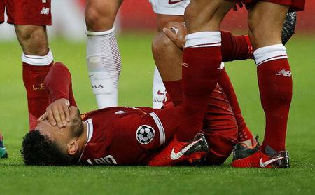 Soccer Football - Champions League Semi Final First Leg - Liverpool vs AS Roma - Anfield, Liverpool, Britain - April 24, 2018 Liverpool's Alex Oxlade-Chamberlain after sustaining an injury REUTERS/Phil Noble