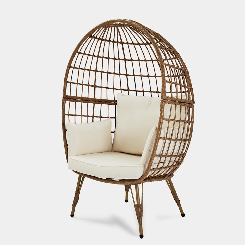 product shot of Kmart's Cocoon Chair with white cushions