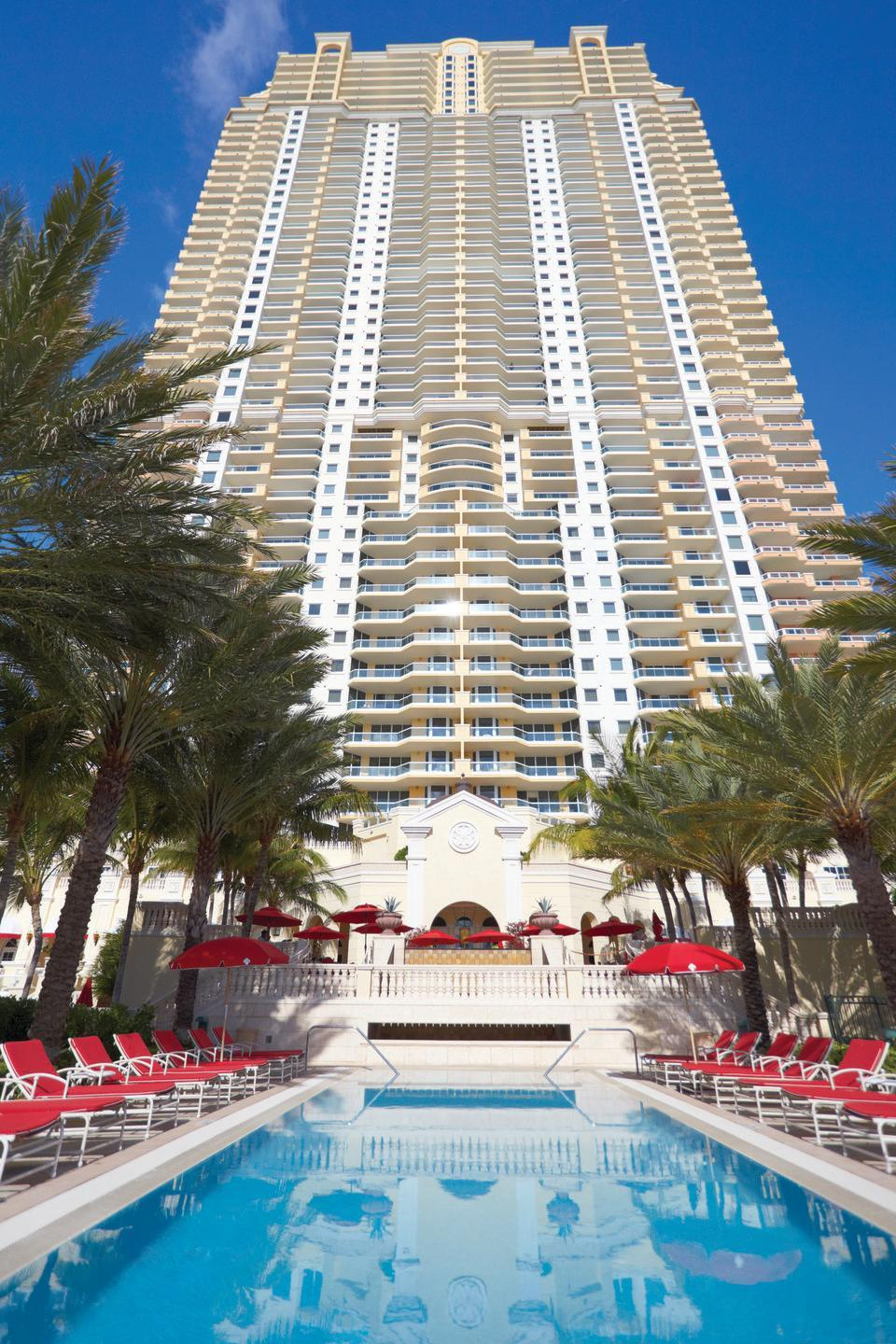 """<p><a href=""""https://www.acqualinaresort.com/"""" rel=""""nofollow noopener"""" target=""""_blank"""" data-ylk=""""slk:Acqualina"""" class=""""link rapid-noclick-resp"""">Acqualina</a> is currently considered """"the best beachfront hotel in the continental U.S.,"""" according to Trip Advisor, and it doesn't take long to understand why. This gorgeous resort, set alongside a pristine strip of Miami Beach, is packed with world-class amenities top-to-bottom, from dining options to pools. It also has some unique offerings, like a reading program, an innovative kids' club, and access to world-renowned golf courses. There's truly something for everyone here.</p>"""
