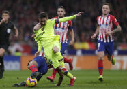 Barcelona's Lionel Messi, front right, duels for the ball with Athletico Madrid's Rodri during a Spanish La Liga soccer match between Atletico Madrid and FC Barcelona at the Metropolitano stadium in Madrid, Saturday, Nov. 24, 2018. (AP Photo/Manu Fernandez)