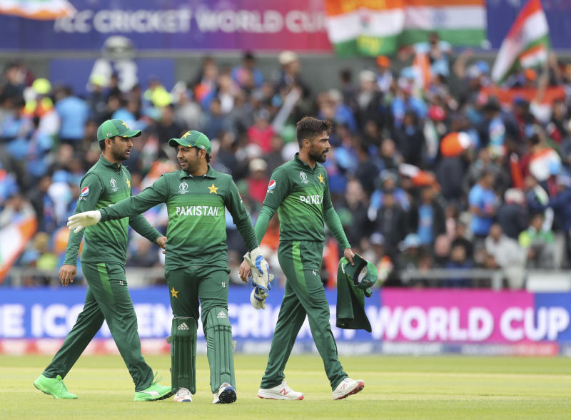 Pakistan's captain Sarfaraz Ahmed, center, and teammates leave at the end of India's innings during the Cricket World Cup match between India and Pakistan at Old Trafford in Manchester, England, Sunday, June 16, 2019. (AP Photo/Aijaz Rahi)