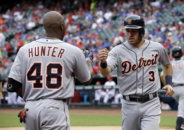 Detroit Tigers' Torii Hunter (48) congratulates Ian Kinsler (3) after Kinsler scored on a Victor Martinez double in the first inning of a baseball game against the Texas Rangers, Wednesday, June 25, 2014, in Arlington, Texas. (AP Photo/Tony Gutierrez)