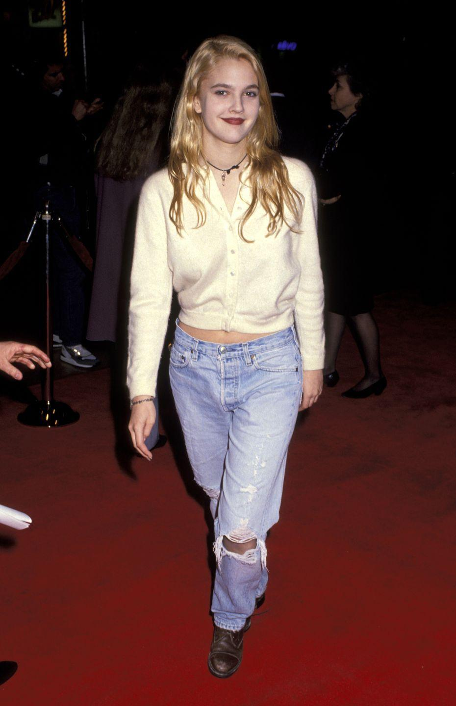 <p>At the <em>Guilty by Suspicion</em> movie premiere, Drew kept it extremely casual in a cardigan, ripped jeans, and brown boots. Is it just me, or did everyone in the '90s underdress for these things?! </p>
