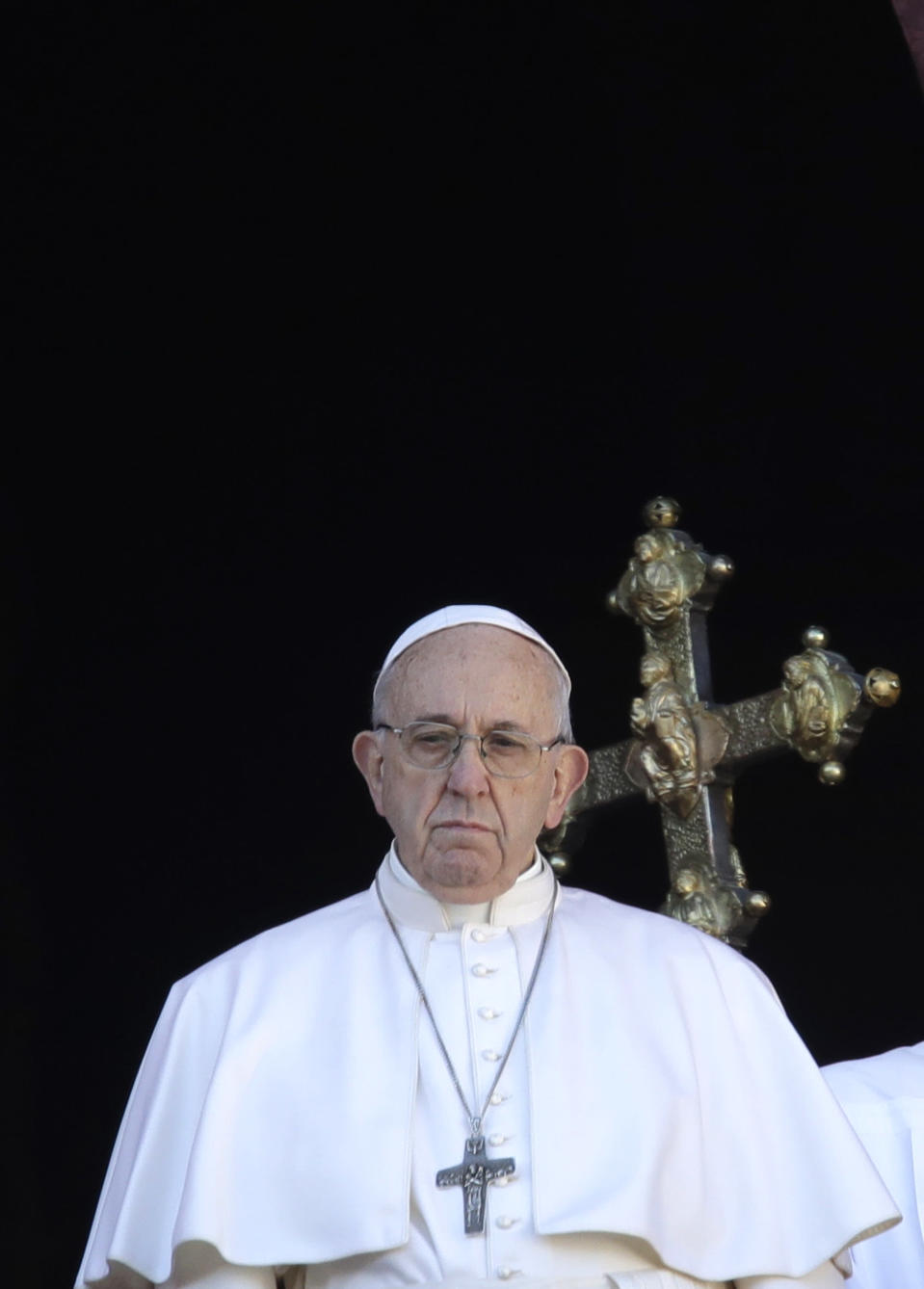 Pope Francis looks at St. Peter's Square after the Urbi et Orbi (Latin for 'to the city and to the world' ) Christmas' day blessing from the main balcony of St. Peter's Basilica at the Vatican, Tuesday, Dec. 25, 2018. (AP Photo/Alessandra Tarantino)
