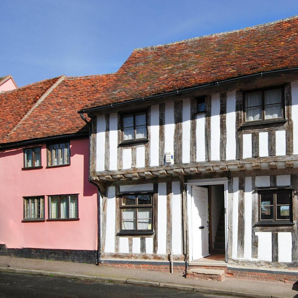 "<p>This is Mint Cottage in Lavenham, Suffolk, whose Tudor style stands out proudly next to its pink neighbour. The traditional Tudor feel carries throughout the property, with high ceilings and exposed beams. We love the beautifully grand four poster bed. Mint Cottage is available through Cool Stays. </p><p><a class=""link rapid-noclick-resp"" href=""https://www.coolstays.com/property/mint-cottage/20499"" rel=""nofollow noopener"" target=""_blank"" data-ylk=""slk:BOOK NOW"">BOOK NOW</a></p>"