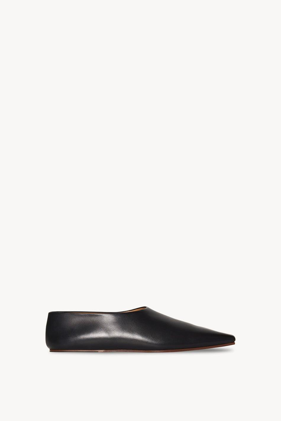 <p><span>The Row Square Toe Flat Pumps in Leather</span> ($990)</p>