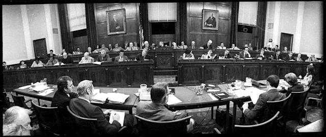 <p>The hearing room of the House Judiciary Committee, July 25, 1974, as the panel began another day of debate on the impeachment question. The members of the committee are seated with Chairman Peter Rodino, D-N.J., in the center of the back row. (Photo: AP) </p>