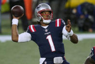 New England Patriots quarterback Cam Newton passes against the Baltimore Ravens in the first half of an NFL football game, Sunday, Nov. 15, 2020, in Foxborough, Mass. (AP Photo/Elise Amendola)