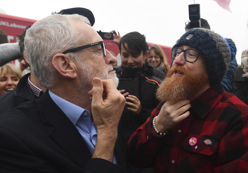 FILE - In this Saturday, Dec. 7, 2019 file photo Labour Party leader Jeremy Corbyn compares beards with a supporter during a visit to Swansea, while on the General Election campaign trail in Wales. (Victoria Jones/PA via AP, File)