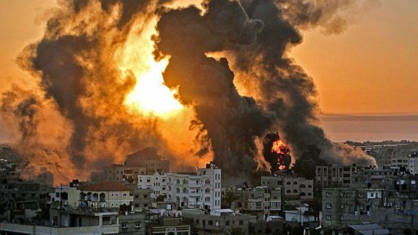 PHOTO: A fire rages at sunrise in Khan Yunish following an Israeli airstrike on targets in the southern Gaza strip, early on May 12, 2021. (Youssef Massoud/AFP via Getty Images)