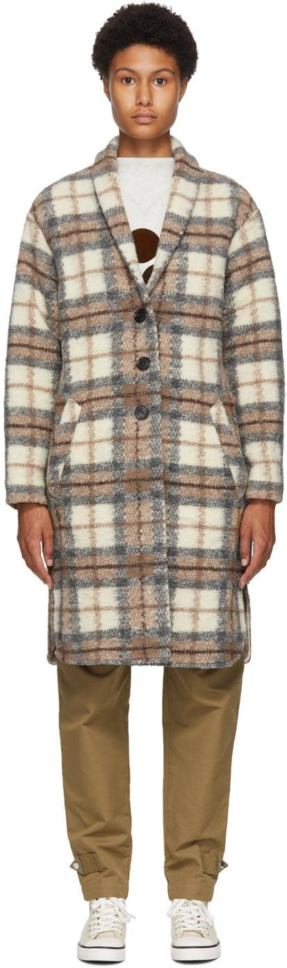 """<p>""""I have been looking everywhere for a plaid coat in neutral tones. I plan to wear this <span>Isabel Marant Etoile Beige Wool Gabriel Blanket Coat</span> ($455) with bone-colored denim and flat boots.""""</p>"""