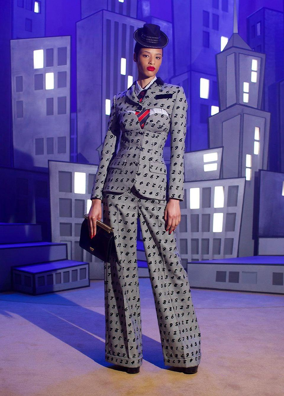 <p>A Moschino show is a <em>show</em>, an experience, a prance through different worlds and scenarios. For the latest tour, Jeremy Scott was inspired by George Cukor's <em>The Women</em> and set out to wardrobe the entire panoply of female tropes. There are boss-heroines in tailored pinstripes; prairie housewives in calico and paisley (plus some potato sacks for good measure); adventurers in safari garb; and, of course, plenty of sirens. Never one to shy away from drama or attention-grabbing elements, Moschino was also stacked with big-name models (like Hailey Beiber, Amber Valletta, Winnie Harlow, Dita Von Teese). It's par for the course at the label, but also feels especially necessary given the entire season is inspired by scene-stealing women.<em>—Leah Melby Clinton</em></p>