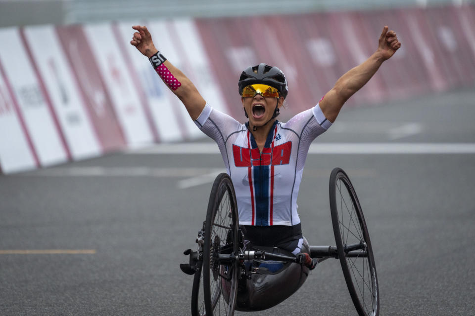 Oksana Masters, from USA, celebrates after wining at Women's H5 Road Race at the Fuji International Speedway at the Tokyo 2020 Paralympic Games, Wednesday, Sept. 1, 2021, in Tokyo, Japan. (AP Photo/Emilio Morenatti)