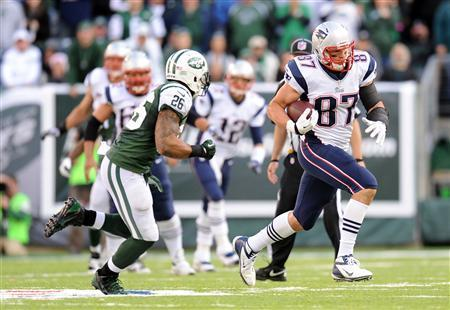 Oct 20, 2013; East Rutherford, NJ, USA; New England Patriots tight end Rob Gronkowski (87) runs after making a catch against the New York Jets during the second half at MetLife Stadium. The Jets won the game 30-27 in overtime. Mandatory Credit: Joe Camporeale-USA TODAY Sports