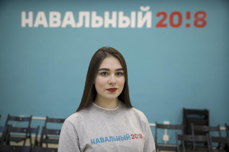 In this photo taken on Friday, March 2, 2018, Russian opposition leader Alexei Navalny supporter Ekaterina Osovskaya, 18, poses for a photo in Moscow, Russia. Vladimir Putin's legacy depends not only on winning re-election Sunday but also on ensuring that today's first-time voters stay loyal to his vision. Nationwide, young people are among his most ardent supporters, but some twenty-somethings who have only known Putin as their leader are frustrated by income equality, corruption and other problems under his all-powerful leadership. (AP Photo/Pavel Golovkin)